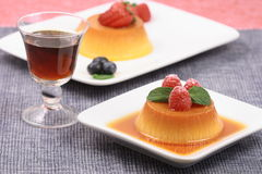 Flan desserts. Delicious flan desserts  with a port shot Stock Photos