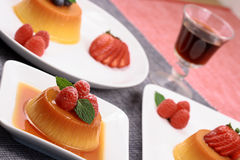 Flan desserts. Delicious flan desserts  with a port shot Stock Image