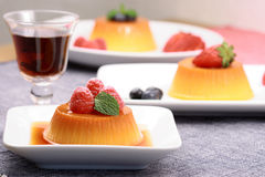 Flan desserts. Made with prime fresh berries followed by a  port liqueur Royalty Free Stock Photo