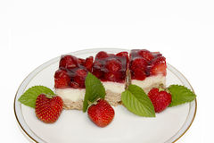 Flan with fresh strawberries and mint leaves Royalty Free Stock Photo