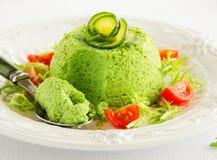 Flan-zucchini cake. With salad Stock Photo