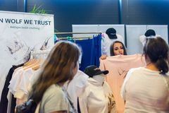 Flanders Expo, Gent Ghent, Belgium, August 17, 2019: Vegan summer festival, sales person showing women clothing