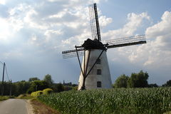 Flanders windmill. Windmill against cloudy sky, Flanders, Belgium Royalty Free Stock Image