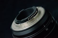 The flange of a F-mountlens, including aperture lever and CPU contacts royalty free stock photo