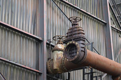 The flanges and old metal constructions in industrial zone Royalty Free Stock Photos