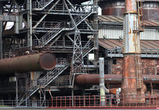 The flanges and old metal constructions in industrial zone Royalty Free Stock Images