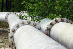 Flanges on the tubes. With water Royalty Free Stock Photos