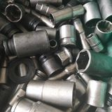 Flank sockets. Assorted dirty flank sockets on the workshop table royalty free stock photo