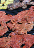 Flank steak barbecue. Flank steak cooking on a barbecue grill stock photo