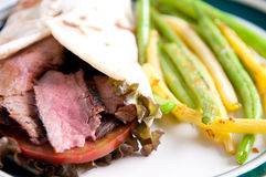 Flank steak burrito, home made flatbread with garlic fried str Stock Photography