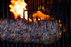 Flank Steak Griling. Flank Steak On The Grill With Fire royalty free stock images