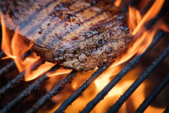 Flank Steak On Grill. With fire in background royalty free stock images