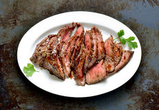 Flank steak. In an oval dish, top view royalty free stock photography