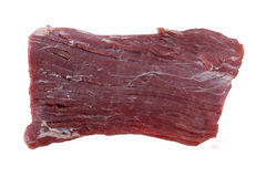 Flank steak raw. A piece of raw flank steak, also known in the US as London broil, isolated on white stock image