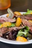 Flank steak salad. With mandarin oranges stock photography