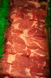 Flank Steak for Sale. A row of flank steak at a grocery market butchers section royalty free stock photography