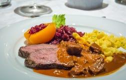 Flank steak whit potato gnocchi and stuffed apricot stock photos