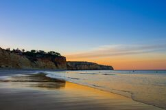 Free Flanked By Tall Cliffs, The Lovely Porto De Mós Beach Is Like A Long Tongue Of Golden Sand. In Lagos,Western Algarve Coastline, Stock Images - 184009624