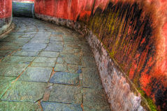 Flanked Stone Walkway. Stone walkway flanked by red walls  in the Wundang Shan Temple in the Hubei district of China Stock Photos