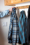 Flannel shirt hung on a mudroom hook Royalty Free Stock Photography