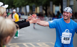 Flap hands of runner and spectator. On Prague Internation Marathon 2012 Stock Photo