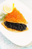 Flapjack with caviar and lemon Stock Photos