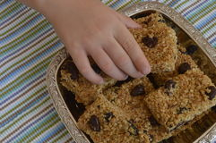 Flapjack. Child's hand reaches for flapjack bar Stock Photography