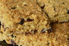 Flapjack. Delicious bar with oatmeal, honey and dried cranberry Stock Photo