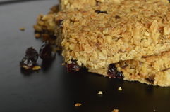 Flapjack. Delicious bar with oatmeal, honey and dried cranberry Royalty Free Stock Photos