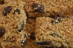 Flapjack. Delicious bar with oatmeal, honey and dried fruit Royalty Free Stock Photo