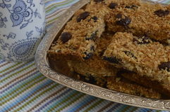 Flapjack. Delicious bar with oatmeal, honey and dried fruit on silver platter Stock Image