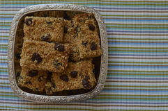 Flapjack. Delicious bar with oatmeal, honey and dried fruit on silver platter Stock Photo
