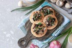 Flapjack with mushrooms and creamy garlic sauce. Flapjack with champignons and creamy bechamel sauce royalty free stock photos