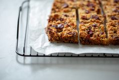 Flapjack vegan with cranberry, apricot and date. Organic vegan flapjack made with dates, cranberries and apricots with no animal products for super healthy diet royalty free stock image