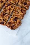 Flapjack vegan with cranberry, apricot and date. Organic vegan flapjack made with dates, cranberries and apricots with no animal products for super healthy diet stock image