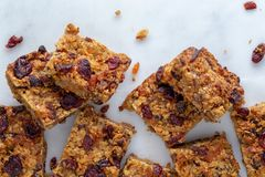 Flapjack vegan with cranberry, apricot and date. Organic vegan flapjack made with dates, cranberries and apricots with no animal products for super healthy diet royalty free stock images