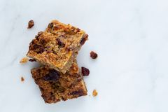 Flapjack vegan with cranberry, apricot and date. Organic vegan flapjack made with dates, cranberries and apricots with no animal products for super healthy diet stock photography