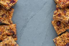 Flapjack vegan with cranberry, apricot and date. Organic vegan flapjack made with dates, cranberries and apricots with no animal products for super healthy diet royalty free stock photos