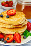 Flapjacks with berries on linen tablecloth Stock Photos