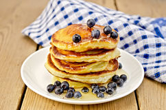 Flapjacks with blueberries and a napkin on the board Royalty Free Stock Image