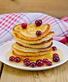 Flapjacks with cranberries and honey on the board Royalty Free Stock Photo
