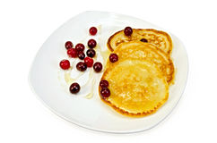Flapjacks with cranberry and honey in a plate Stock Photo