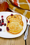 Flapjacks with cranberry in a plate on a board Royalty Free Stock Image