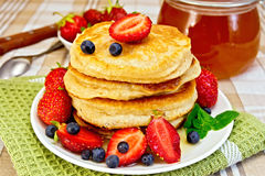 Flapjacks with strawberries and blueberries Stock Image