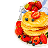Flapjacks with strawberries and blueberries Royalty Free Stock Photography