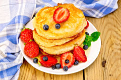 Flapjacks with strawberries and blueberries Stock Photo