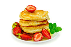 Flapjacks with strawberries and mint in plate Royalty Free Stock Photo