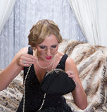 Flapper dress lady with lorgnette stock image
