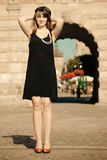 Flapper girl woman in1920s style standing on the street Royalty Free Stock Image