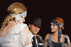 Flapper girls and gangster. Flapper girls and young gangster in the bar stock image